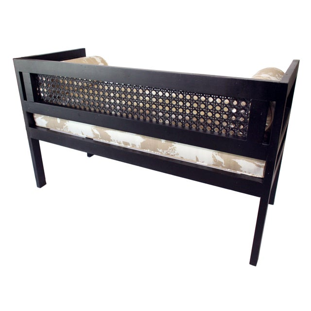 This mid-century walnut and cane bench has been painted matte black and completely re-upholstered in a Chinoiserie reverse...