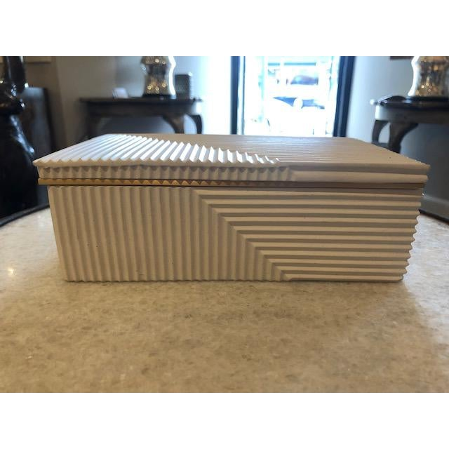 Cream Cement Box with a gold lining and black velvet interior. Small storage for multiple uses.