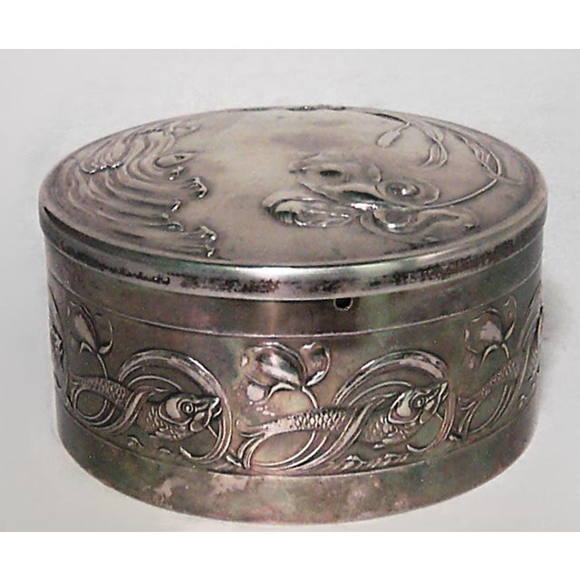 French Art Nouveau silver round shaped box with cranberry glass liner and floral design