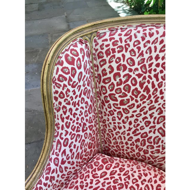Stylish 1940s Louis XV accent chair in lively red leopard upholstery. Cabriole legs and carved arms.