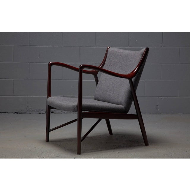 Designed in 1945 by Finn Juhl for a collaboration with Niels Vodder, the NV45 armchair is an iconic design. This armchair...