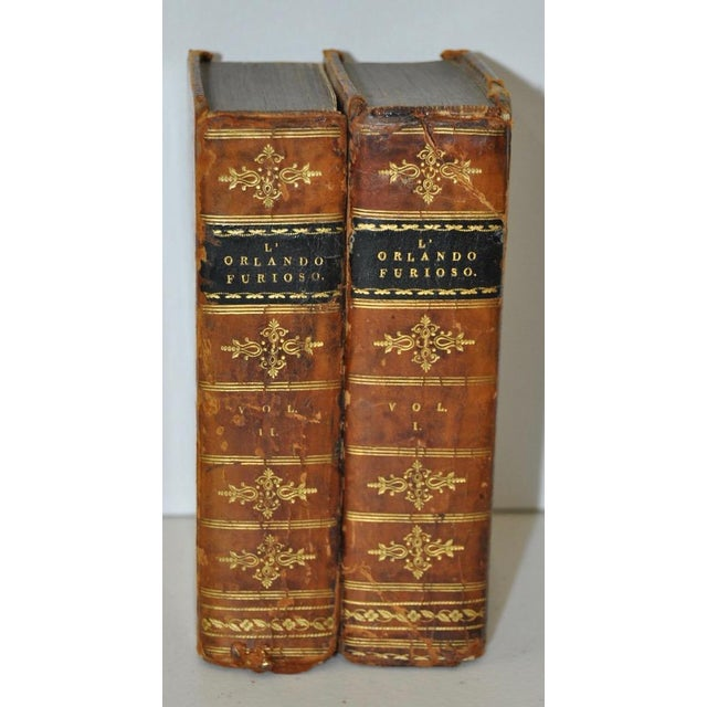 L' Orlando Furioso Volumes One and Two. One front cover is missing. These are bound in leather, and appear to be all...