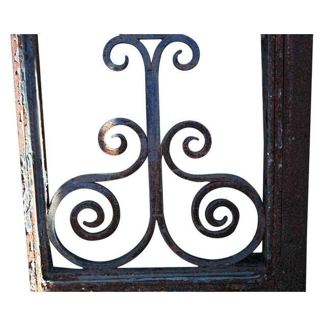 This is an original wrought iron door transom window from the turn of the century. The iron is all original, except for...