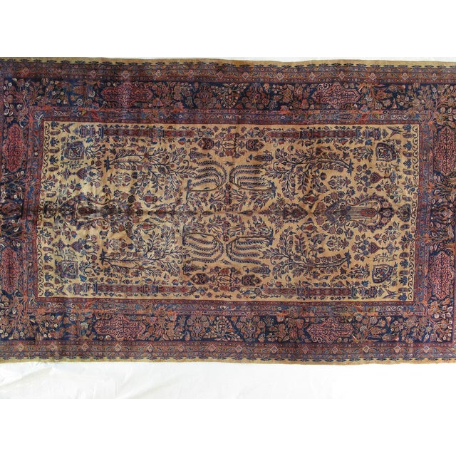 A beige, Manchester wool pile rug that is very fine hand woven antique Persian Kashan carpet in excellent condition with...