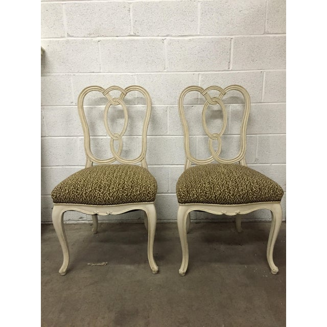 These vintage ribbon-back wood chairs have been newly re-upholstered in a brown and white Jane Shelton animal print...