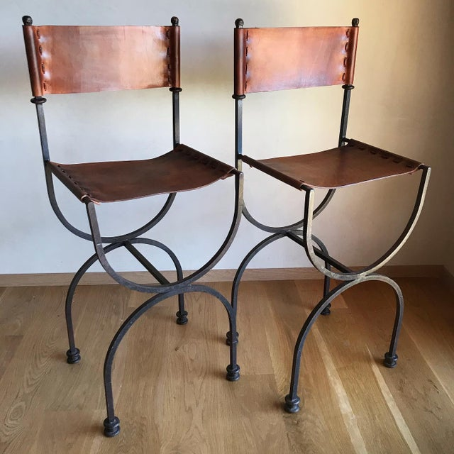 Angel I. Pazmino Rare Vintage Restored Hand Forged Solid Iron Campaign Safari Spanish Saddle Leather Rustic Neoclassical Bar Stools - a Pair For Sale - Image 4 of 13