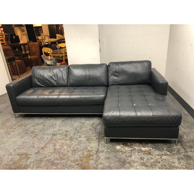 Design Plus Gallery has a Natuzzi Silvio sectional. The Natuzzi Silvio sectional has a Mid Century Modern design with...