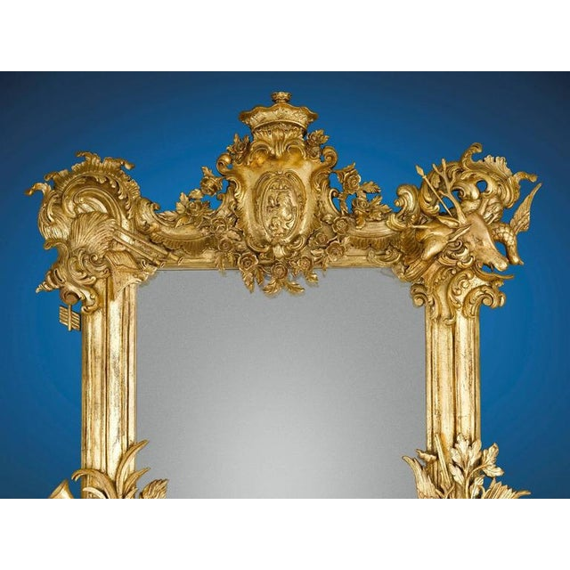 Copiously carved musical and hunting elements charaterize this superior 19th century French giltwood mirror. The motif...