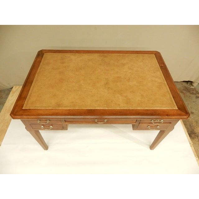 19th century French walnut four drawer leather top desk.