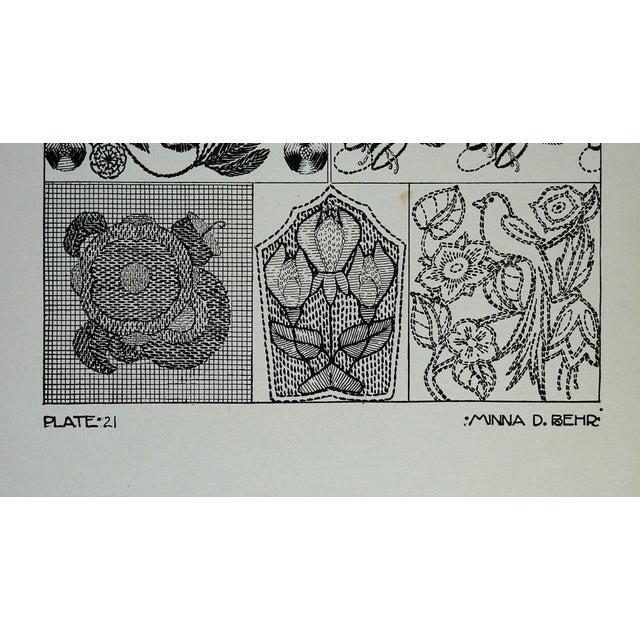 Circa 1920's textile embellishment designs by Minna D. Behr. Plate 19, black on gray heavy stock paper. Corner bumps.