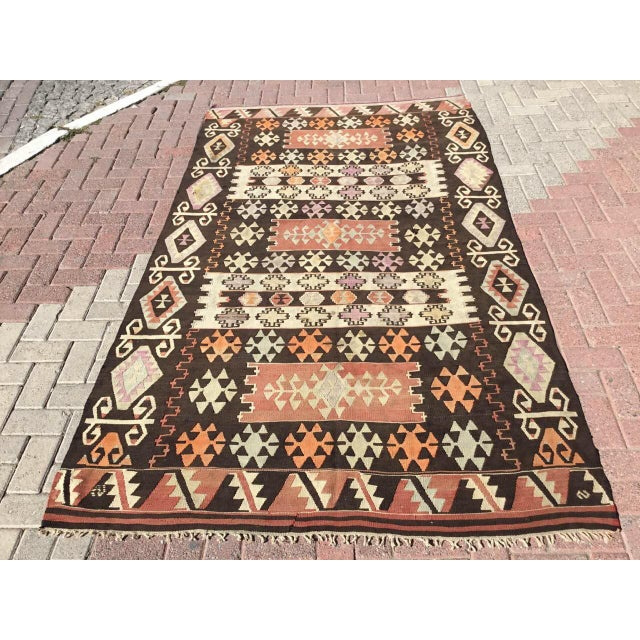 This beautiful, vintage, handwoven kilim is approximately 70 years old. It is handmade, of very fine quality hand spun...