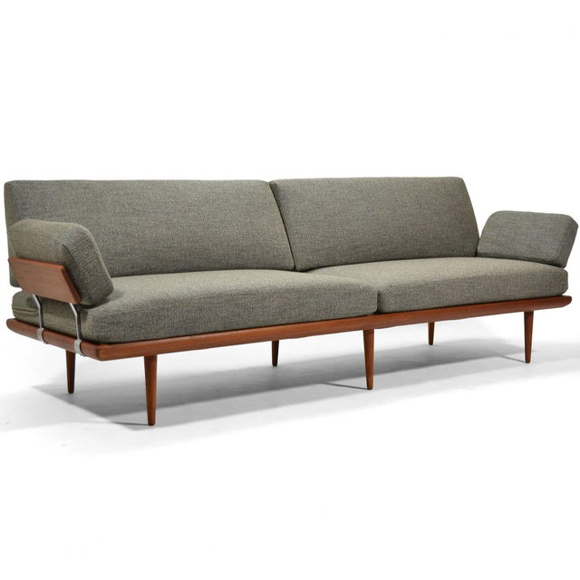 Finely crafted by France & Søn, this rare, extra large version of the Minerva sofa or daybed has a frame of solid teak...