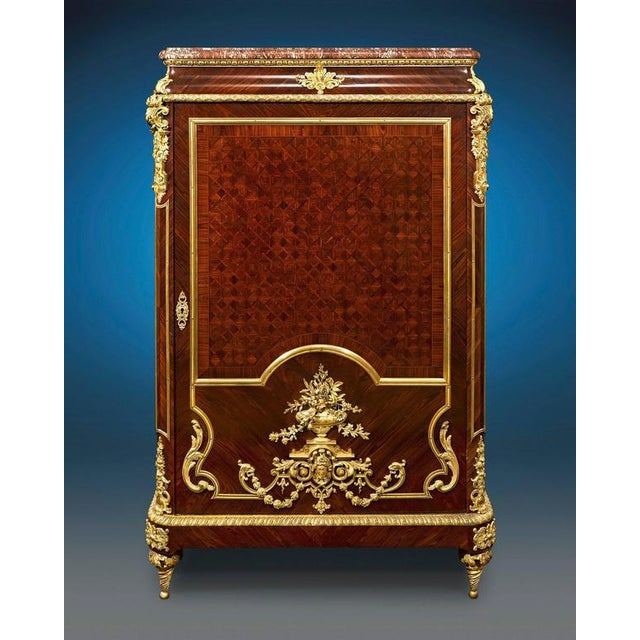 Enveloped in sumptuous parquetry and doré bronze, this majestic Louis XIV inspired French linen press displays the...