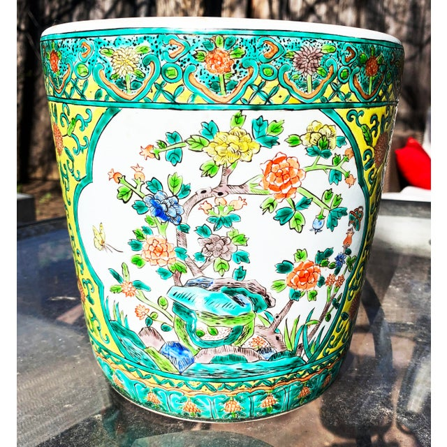 Yellow Chinoiserie Porcelain Pot Accented With Green Foliate and Floral Motifs. Felt protectors on base. Dimensions approx...