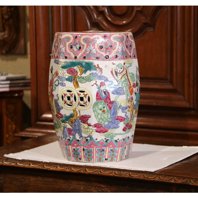 """This colorful vintage garden seat was created in China, circa 1970. The ceramic """"Famille Rose"""" porcelain stool is pierced..."""
