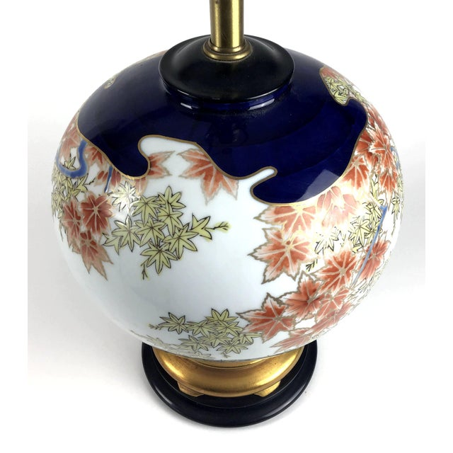 Beautiful design on this Marbro lamp. Japanese motif with gold details and complete with harp and matching finial. No...