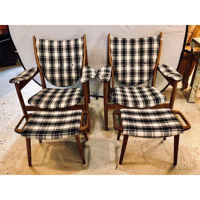 Pair of Mid-Century Modern style plaid fabric lounge chairs with ottomans. Each sleek and stylish lounge chair with a wide...