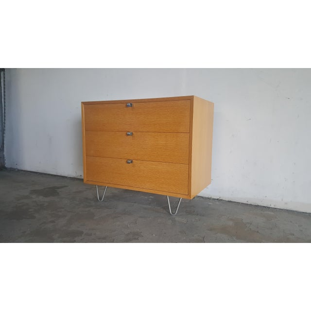 Absolutely gorgeous iconic mid century modern 3 drawer chest by George Nelson for Herman Miller. Sitting beautifully on...