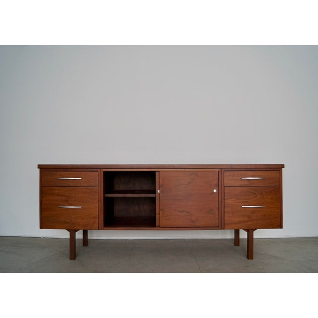 For sale is this original vintage mid-century modern credenza. It has been professionally refinished, and is impeccable....