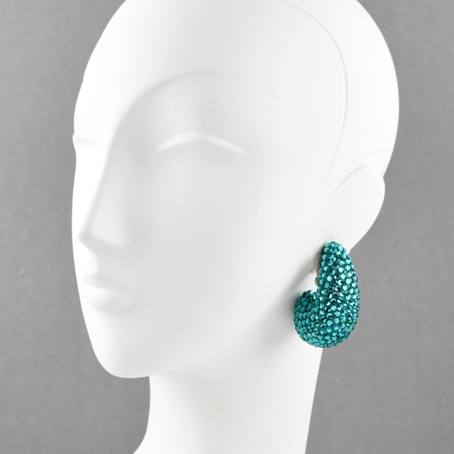 Elegant statement clip on earrings designed by Richard Kerr in the 1980s. They are made up of his signature pave crystals....