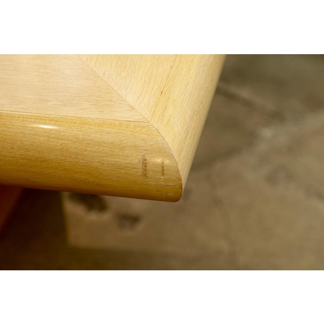 A Steve Chase / Arthur Elrod designed custom dining table made by Philip Sicola of Culver City California. This oak...