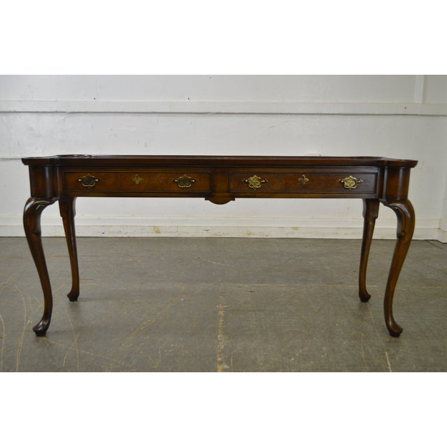 STORE ITEM #: 15868-fwmr Hekman Burl Wood Queen Anne 2 Drawer Console Table AGE/COUNTRY OF ORIGIN – Approx 25 years,...