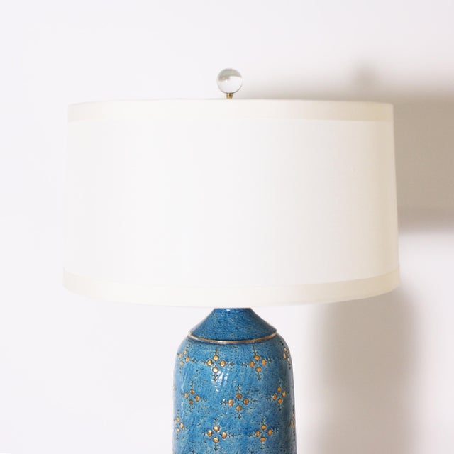 Blue Marbro ceramic lamp, c. 1960 Custom linen shades, crystal ball finial, Lucite base, gold twisted cording.