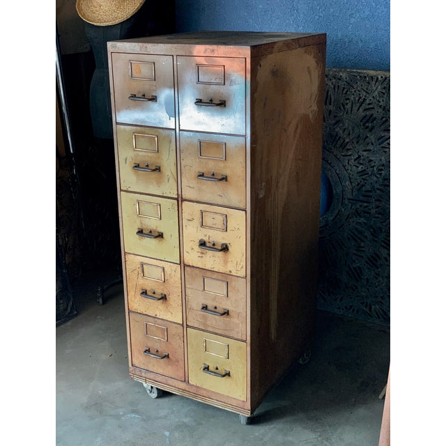 Nope, he may not be glamorous but he's got game! But what this vintage industrial rolling 10-drawer 1940s Metal File...