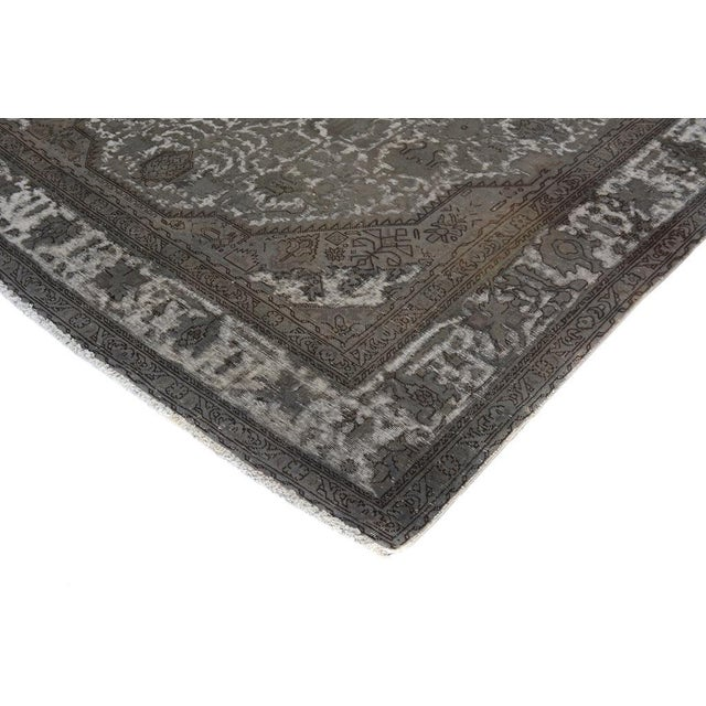 Stunning vintage rug hand knotted superbly using the finest quality wool to give it an excellent distressed look and...