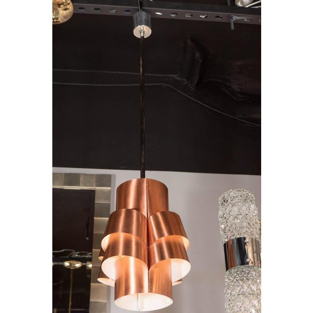A stunning Mid-Century Modernist segmented pendant lamp in brushed copper by Hans-Agne Jakobsson. Brushed copper segments...