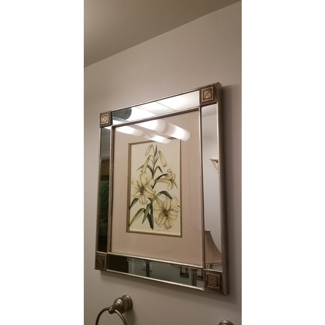 Very elegant dual function wall decor mirror and art piece. Lovely in any room living space, kitchen, dining , bedroom or...