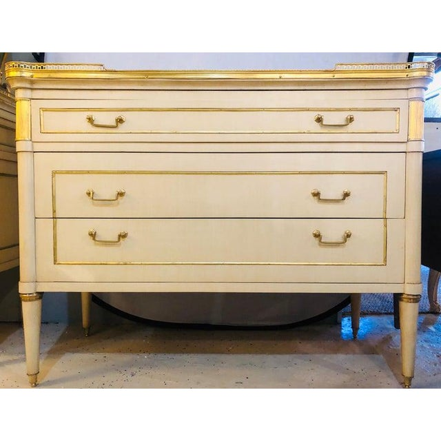 Pair of Maison Jansen style Hollywood Regency marble top mounted cream commodes. This is a stunning pair of large and...