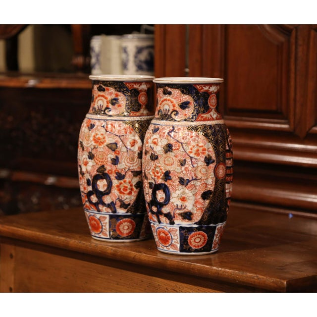 Decorate a mantel or a buffet with this colorful pair of antique Imari vases; crafted in China, circa 1880, the...