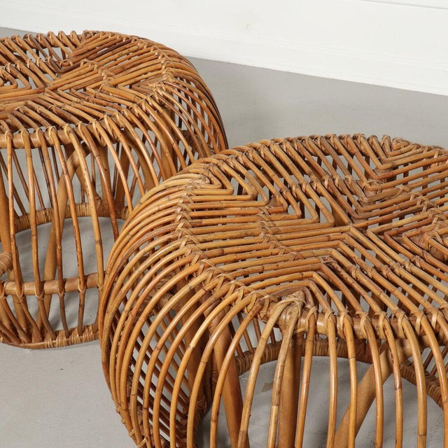 A pair of organic shaped hand woven wicker/rattan poufs, stools or side tables in the manner of Italian designer Franco...