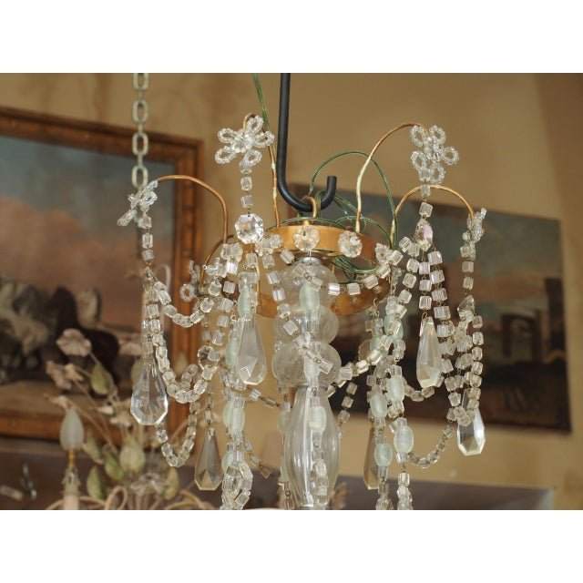 Very precious and dainty crystal and bronze french chandelier. Six iron arms covered with tole acanthus leaf design, swags...
