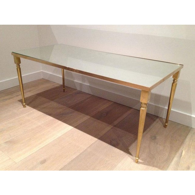 1960's Pair of Jansen Brass Coffee Tables. Mirrored Glass. Priced per pair.