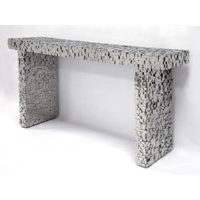 Kam Tin Pyrite console Console covered with natural pyrite Measures: H 76 cm; W 143 cm; D 33 cm Stamped Kam Tin France,...