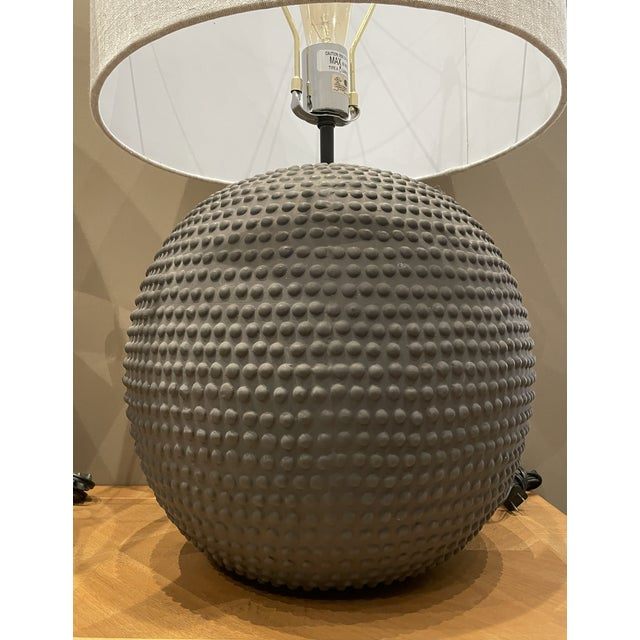 Textured Ceramic Lamps in Black Clay with a soft linen shade. These lamps are highly versatile in any space and have an...