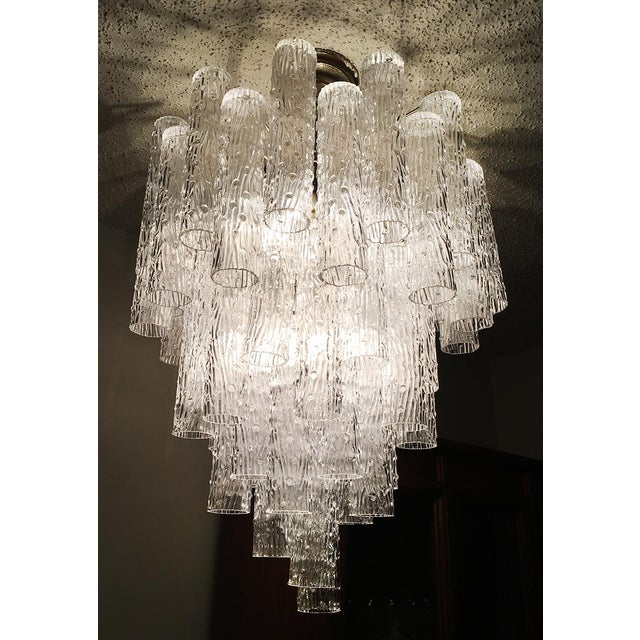 Gorgeous Art Glass fixture from Murano's finest production. This chandelier can be dated between the late 50s and the...