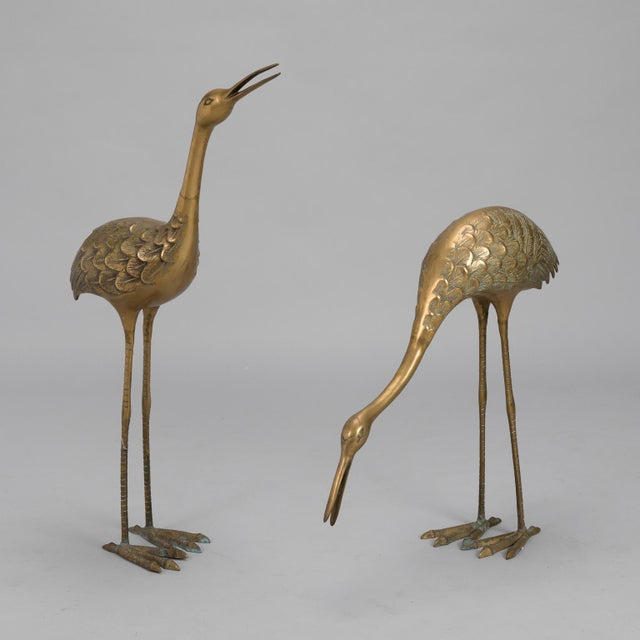 Circa 1970s pair tall cranes or herons rendered in brass found in Italy. Unknown maker and origin. Taller crane...