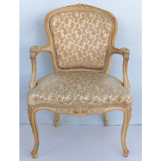 Offered for sale are a late 19th-early 20th century pair of Louis XV style French provincial fauteuil armchairs. Both...
