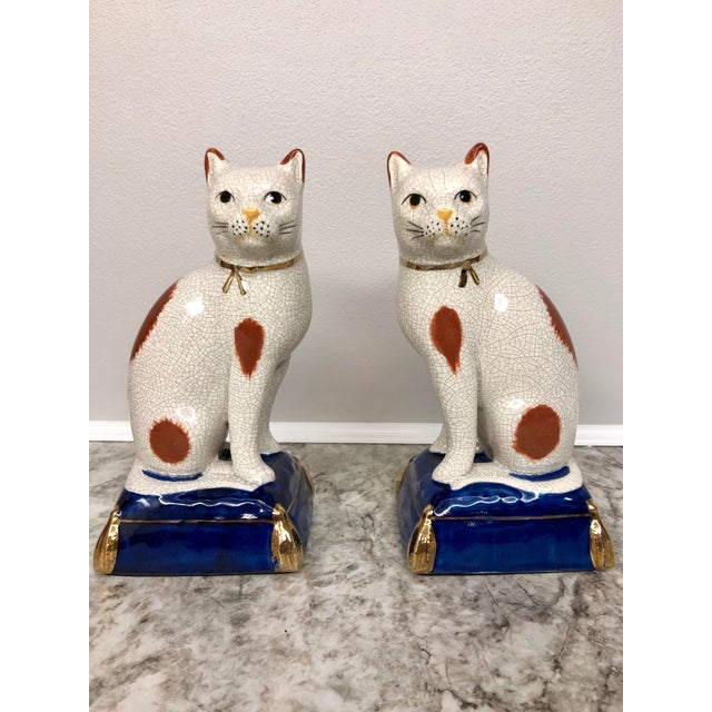 Vintage cat Fitz and Floyd bookends or statues a pair. Beautiful calico cats stirring on a royal blue pillow with gold...