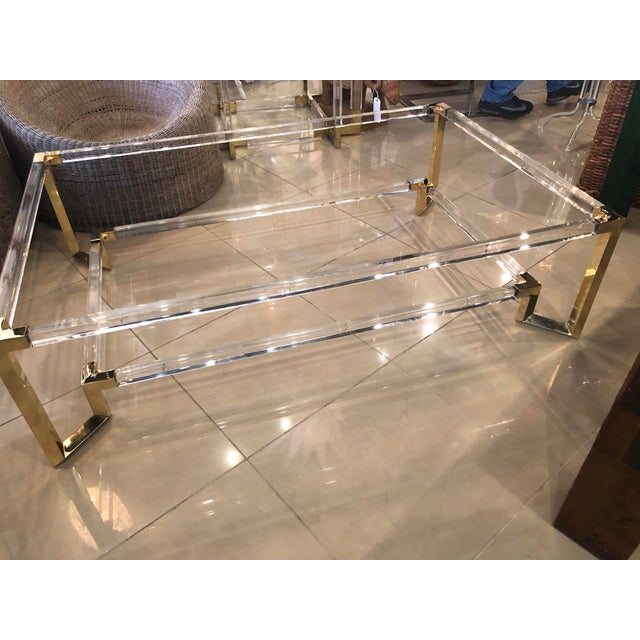 Amazing vintage lucite and brass, Two Tier Glass Top, coffee cocktail table. The lucite and the brass have both been...