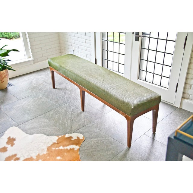 Walnut bench w/ laser cut cowhide upholstered seat -Mid-century modern style -Walnut frame -Laser cut printed cowhide...