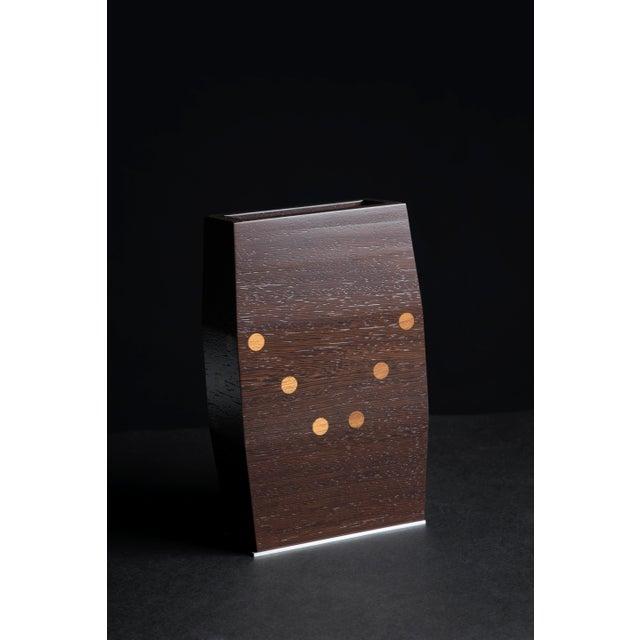 Luxury homewares are entering Pitsikas handmade luxury furniture collection: a hand-made wooden teak (Burma) & wenge vase...