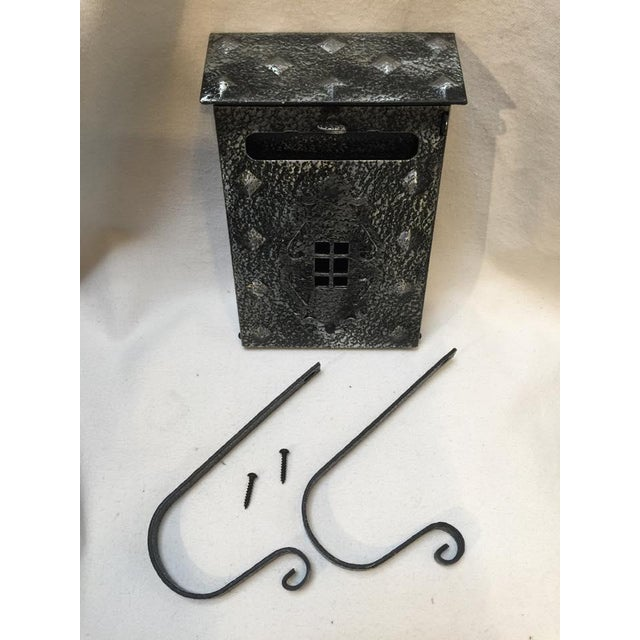 Cool new metal 'original' reproduction of the Tudor style mailbox. Comes with optional newspaper hooks. Holes in front so...