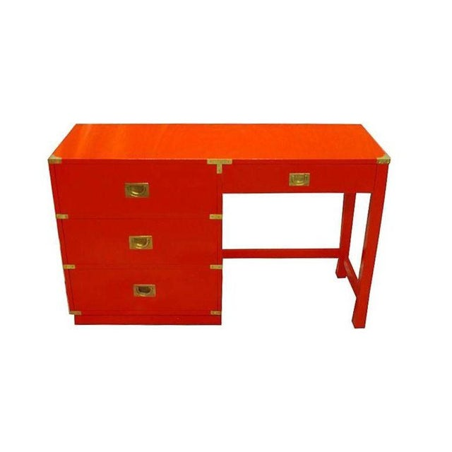 This is a beautiful high gloss fire engine red lacquer Campaign desk by Drexel Heritage. Featuring three drawers with...
