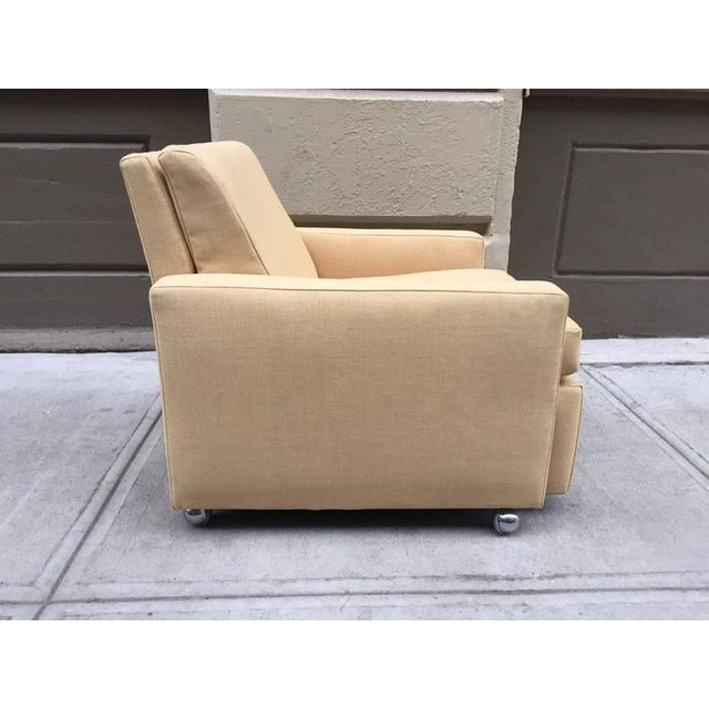 """Pair of reclining lounge, cube chairs by Milo Baughman. Upholstered and on casters. Measures (as shown) 29.5"""" W x 29.5""""H x..."""
