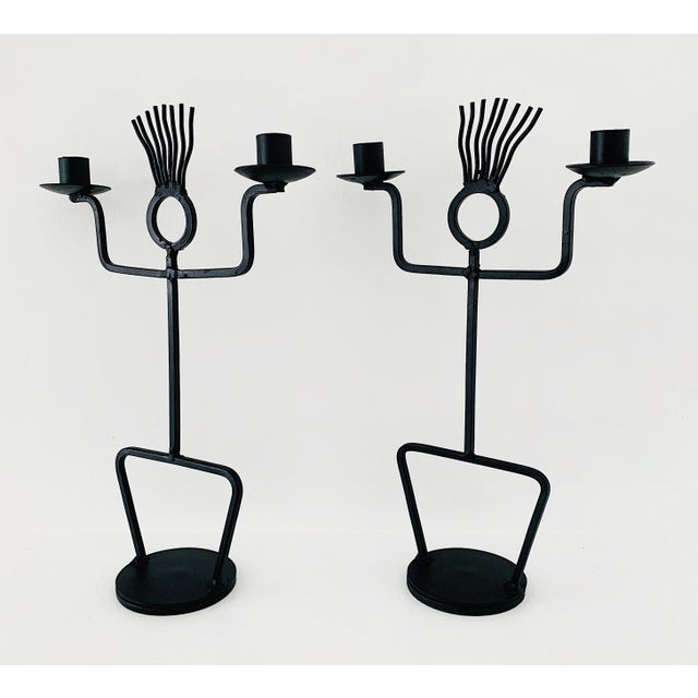 A pair of vintage wrought iron sculptural candle holders, circa 1970's in excellent condition.