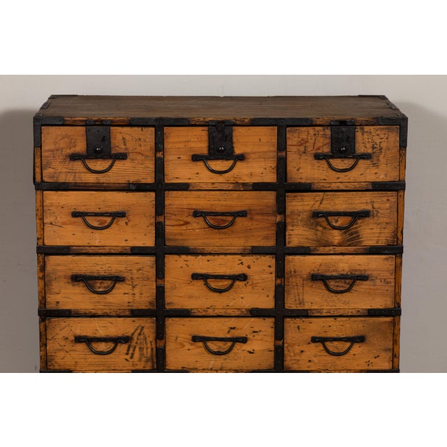 Antique tansu. Multiple drawers. Original hardware. Sitting on custom metal base.